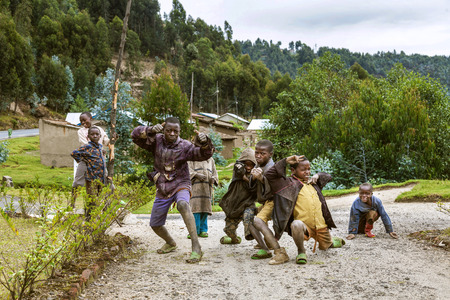 understood: Byumba, Rwanda, Africa - September 6, 2015: Unidentified children. The faces of Africa. The children who are understood as poor from their old clothes and shoes pose happily.