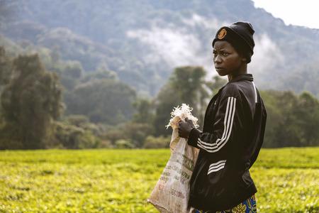 laborer: Kigali, Rwanda, Africa - September 7, 2015: Unknown young laborer girl is prepared to work. Rwanda tea plantations.