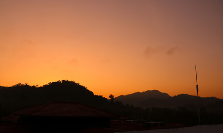 faintly visible: beautiful sunrise view over the hill