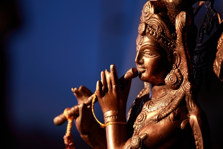 dwarsfluit: Krishna holding flute Stockfoto