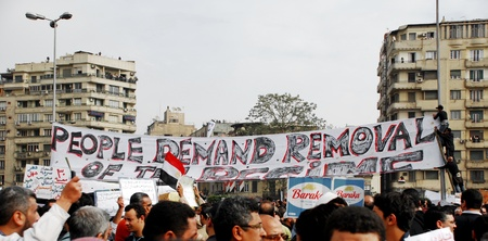thousands: CAIRO - FEB 1: Egyptian anti-government protesters attach a big banner in Cairo. Feb 1, 2011 Editorial