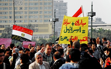 masr: CAIRO - FEB 1: Groups of Egyptian anti-government protesters hold banners and signs against Mubarak. Cairo, Feb 1, 2011