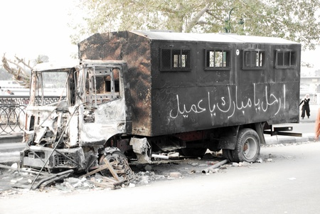 masr: CAIRO - 01 FEBRUARY: Burnt out riot police truck. Cairo, Feb 1, 2011  Editorial