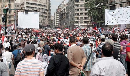 CAIRO - SEPTEMBER 9: Thousands of Egyptians converged on Cairos Tahrir Square on Friday to demand reforms in a turnout dubbed correcting the path of the revolution.  Cairo, September 9, 2011