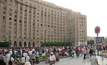 converged: CAIRO - SEPTEMBER 9: Crowds of Egyptians converged by Tahrir building on Friday to demand reforms in a turnout dubbed correcting the path of the revolution.  Cairo, September 9, 2011
