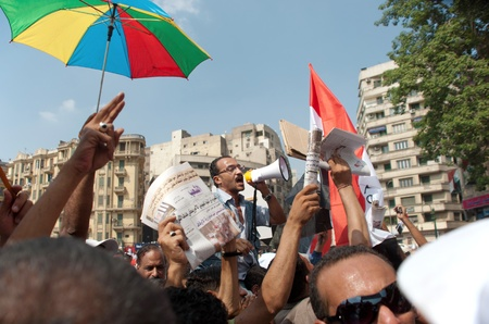 converged: CAIRO - SEPTEMBER 9: Crowds of Egyptians converged on Cairo Editorial