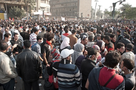 CAIRO – NOVEMBER 22: Groups of Egyptians with gas masks gather in Tahrir square. Cairo, November 22, 2011