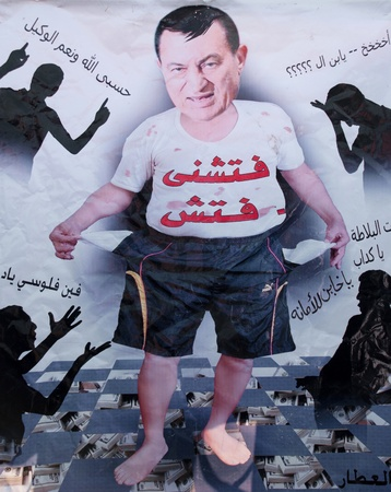 CAIRO – JAN 25: Poster shows Hosni Mubarak as a little kid stands over a huge pile of US Dollar with sarcastic graffiti. Cairo, Egypt. January 25, 2012 Editorial