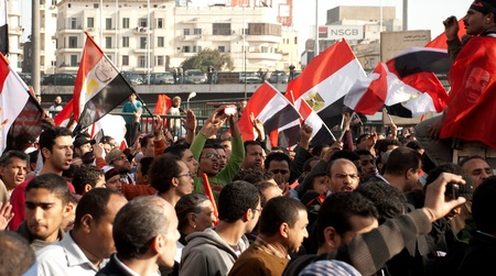 masr: CAIRO � JAN 25: Groups of Egyptians walk in a giant march across down town area during first anniversary of Egypt