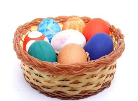 hard boiled: Colored Easter Eggs In a plastic plate on a white background