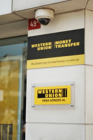 public transfer: Istanbul, Turkey - May 31, 2012: Western Union name and logo posted on a wall
