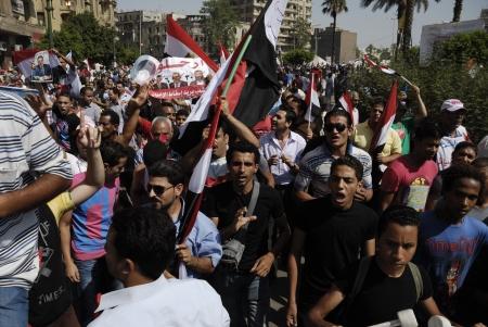 resignation: CAIRO - JUNE 30: Anti Muslim BrotherhoodMorsi protesters in Tahrir Square shout slogans calling for Morsis resignation on June 30, 2013 in Cairo, Egypt. Editorial