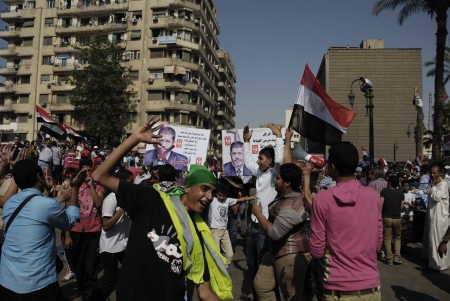 muhammed: CAIRO - JUNE 30: Unidentified teenage guys and children dance and shout slogans against Muslim Brotherhood and the President Muhammad Morsi as a way of protesting in Tahrir Square on June 30, 2013 in Cairo, Egypt Editorial