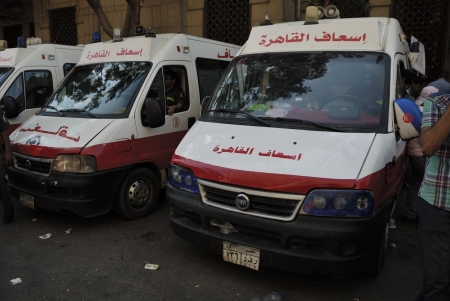 muhammed: CAIRO - JUNE 30: Ambulance vans near Tahrir Square ready for emergency during the anti Muslim BrotherhoodMorsi protests in the Square on June 30, 2013 in Cairo, Egypt Editorial