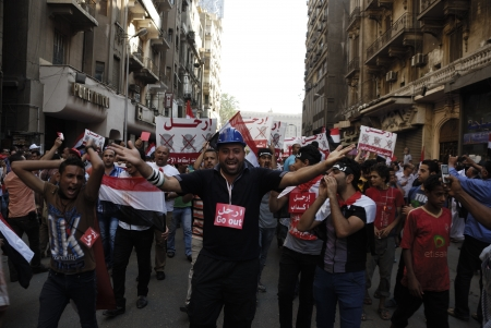 resignation: CAIRO - JUNE 30: Anti Muslim BrotherhoodMorsi protesters in Tahrir street shout slogans calling for Morsis resignation on June 30, 2013 in Cairo, Egypt. Editorial