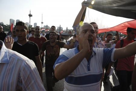 resignation: CAIRO - JUNE 30: Unidentified anti Muslim BrotherhoodMorsi protesters over Qasr el-Nil bridge shout slogans calling for Morsis resignation on June 30, 2013 in Cairo, Egypt.