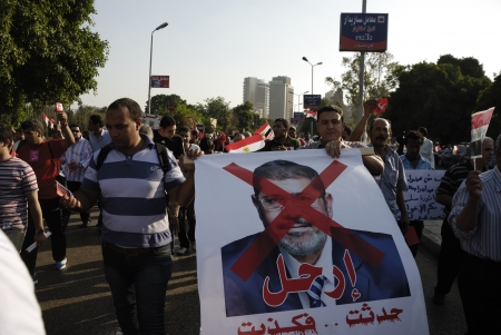 muhammed: CAIRO - JUNE 30: Anti Muslim BrotherhoodMorsi protesters in el-Tahrir Street hold a photograph of the President Muhammad Morsi with a text says Go Away! June 30, 2013 in Cairo, Egypt Editorial