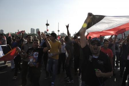 resignation: CAIRO - JUNE 30: Anti Muslim BrotherhoodMorsi protesters over Qasr el-Nil bridge shout slogans calling for Morsis resignation on June 30, 2013 in Cairo, Egypt.