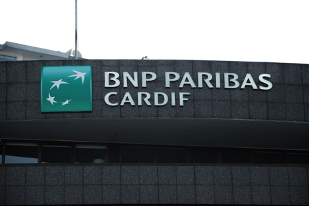 paribas: ISTANBUL - JUNE 11: BNP Paribas bank branch in Istanbul, Turkey on June 11, 2012. BNP Paribas bank was founded on 23 May 2000 in Paris, France. It was ranked by Bloomberg and Forbes as the 4th largest bank in the world, as measured by total assets.