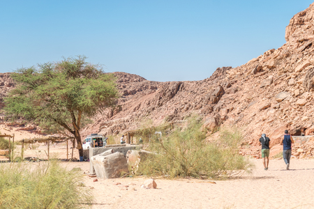 Colored canyon in Nuweiba Dahab Egypt . Coloured Canyon is a rock formation on Sinai peninsula. It is a labyrinth of rocks, some of them have about 40 meters. The canyon is almost 800 meters long. The nearest town to the canyon is Nuweiba. It is about 90 km north of Dahab.