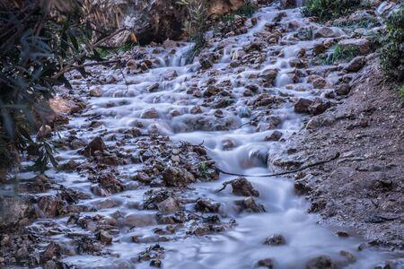 water flows across Al-Mazrah valley in the north of Jordan Banco de Imagens