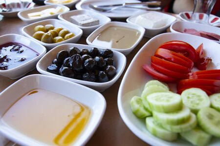 A typical Turkish breakfast consists of cheese (beyaz peynir, kaşar etc.), butter, olives, eggs, tomatoes, cucumbers, jam, honey, and kaymak, sucuk (spicy Turkish sausage, can be eaten with eggs), pastırma, börek, simit, poğaça and soups are eaten as a morning meal in Turkey.