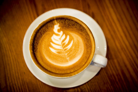 brewage: Cup of coffee with Christmas tree latte art. Stock Photo