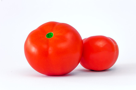 rapprochement: nice two shinning red tomatoes ready for cooking