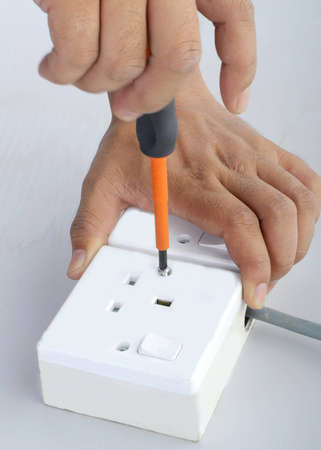 repair of the electric socket close up photo