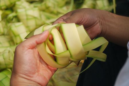 casing: Ketupat weaving using coconut leaf to make casing where rice will be put into the casing and then cook it.