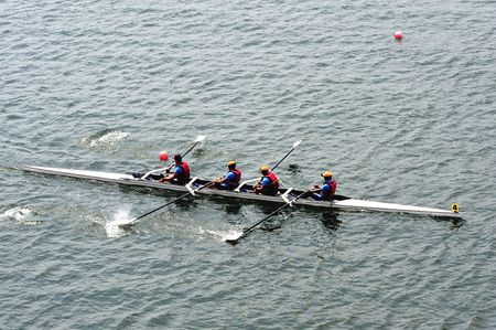 quadruple: Rowing in Putrajaya lake Malaysia. Stock Photo