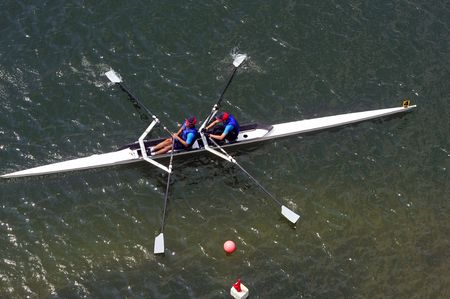 sculling: Rowing Teamwork Stock Photo