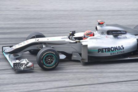 Sepang F1 Circuit, Malaysia - April 2, 2010 – Michael Schumacher of  Petronas Mercedes GP formula one racing team practicing during Petronas Malaysian Grand Prix 2010 April 2-4, Sepang Editorial