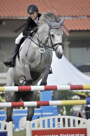 Putrajaya, Malaysia - May 15th, 2010 - A competitor performing in show jumping competition during Premier Cup 2010