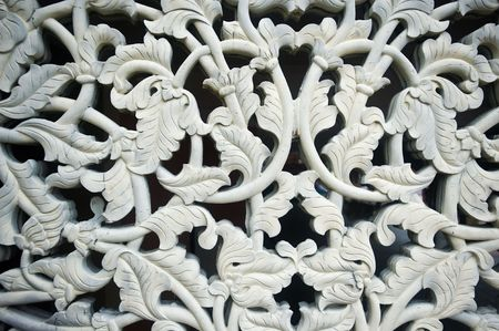 carving: Cement carving of rose leaf motif. Stock Photo