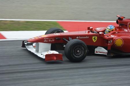 scuderia: Sepang International Circuit, Malaysia - April 08th to 10th, 2011 – Fernando Alonso the driver for Scuderia Ferrari Formula One racing team testing the car during Petronas Malaysia Grand Prix 2011.
