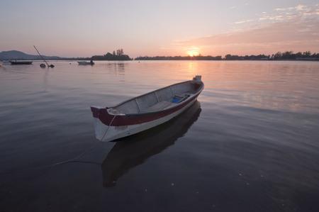 Boat at Gayang Fisherman Village on  Sunset Background