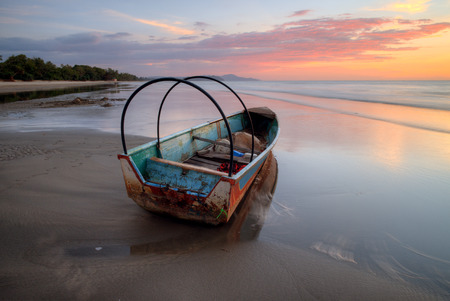 Boat at Sabah Beach on sunset background