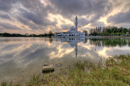 islamic wonderful: Beautiful Floating Mosque Tengku Tengah Zaharah Kuala Ibai, Terengganu, Malaysia during sunset moment Stock Photo