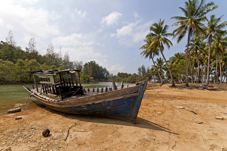 lovelorn: Stranded Fishing Boat at Terengganu, Malaysia during Sunny day. Stock Photo
