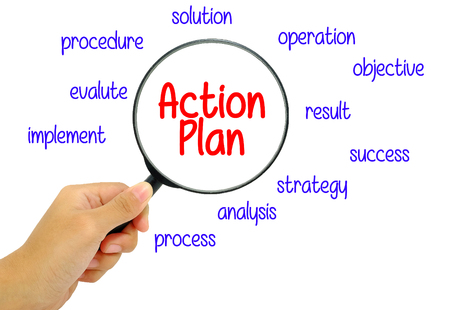 action plan: Hand holding magnifying glass with words action plan concept.