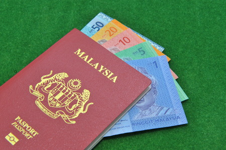 bank notes: Malaysia bank notes and Malaysia Passport Stock Photo
