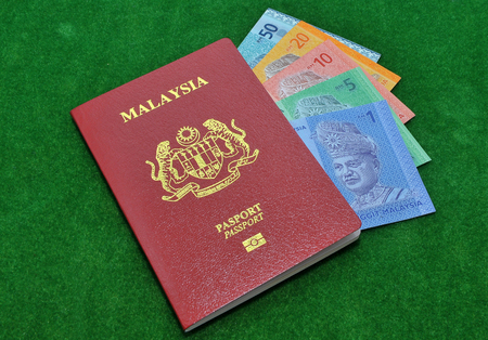 immigrate: Malaysia bank notes and Malaysia Passport Stock Photo