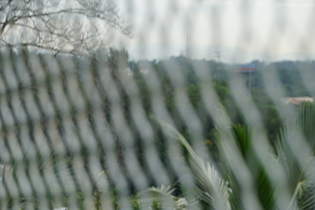 welded: blur image of iron fence