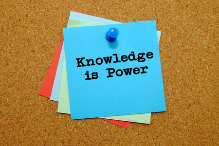 CHALLENGING: Knowledge is power written on colored sticker notes over cork board background.