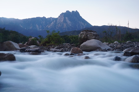 river rafting: Beautiful Shallow Rapid River With Mount Kinabalu In Background