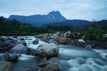 lows: Beautiful view River with Mount Kinabalu, the highest peak in the Malay Archipelago, Borneo, East Malaysia Stock Photo