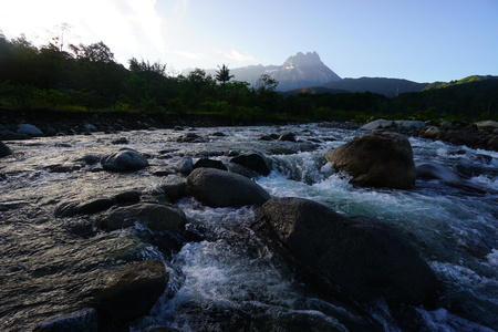 lows: Beautiful River With Mount Kinabalu In Background Stock Photo