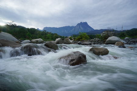 hugh: Beautiful River With Mount Kinabalu In Background Stock Photo