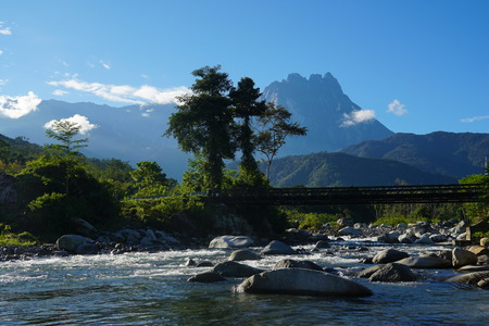 A peaceful morning view at Borneo river with Mount Kinabalu background Stock Photo